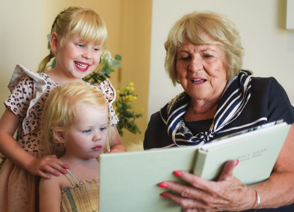 Grandmother reading to Grandchildren on Mothers Day at The Richardson aged care